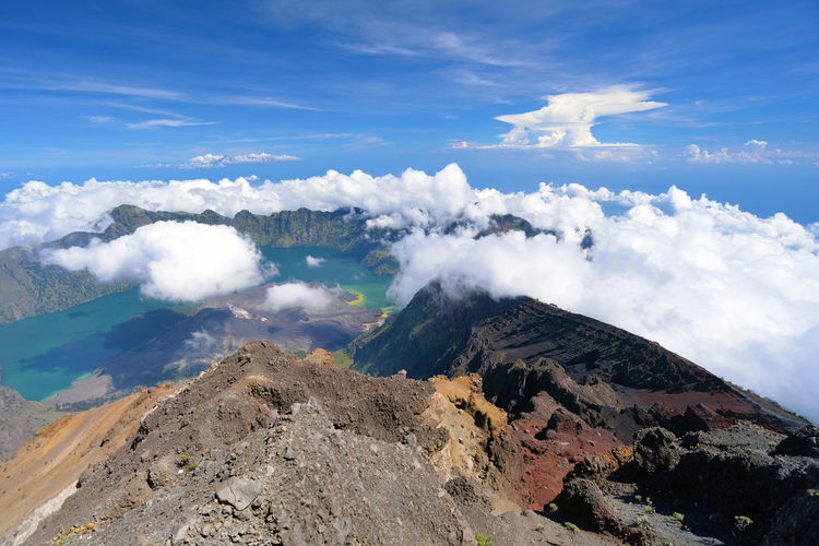 Scenic View Of Clouds Over Volcanic Landscape Against Sky