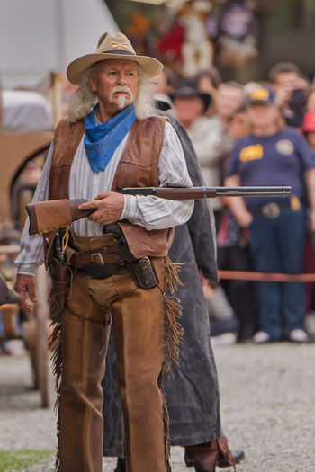 Bill Cody Buffalo Buffalo Bill Casual Clothing Cowboy Cultures Day Focus On Foreground Gun Leisure Activity Lifestyles Outdoors Portrait Western Western Script Winchester
