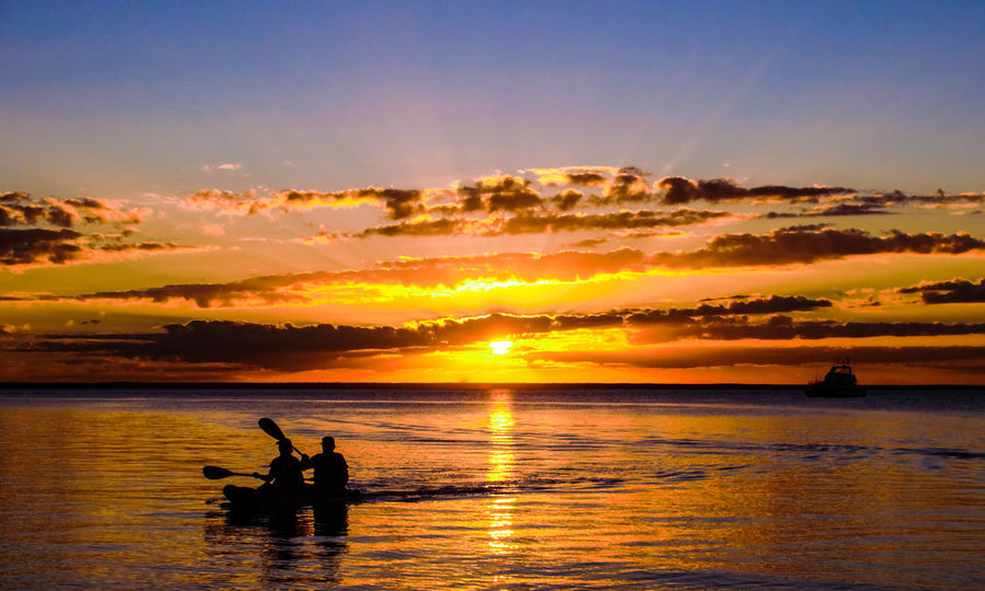 Lost In The Landscape Beauty In Nature Cloud - Sky Day Horizon Over Water Kayak Fishing Leisure Activity Men Nature Nautical Vessel Outdoors People Real People Reflection Scenics Sea Silhouette Sky Sunset Togetherness Tranquil Scene Tranquility Two People Water Waterfront