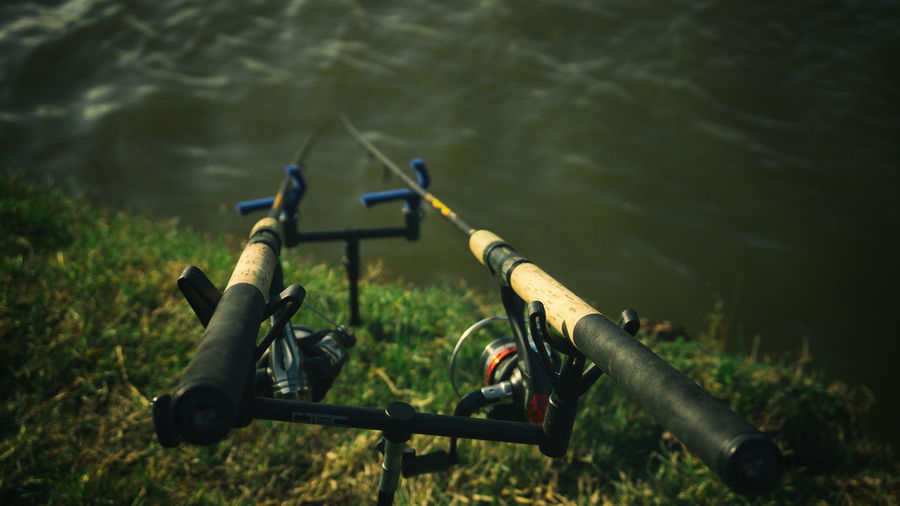 Close up of two spinning rod fishing gear equipment hobby