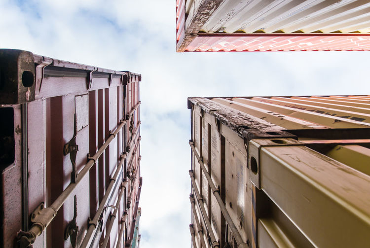 Low Angle View Of Cargo Container Against Sky