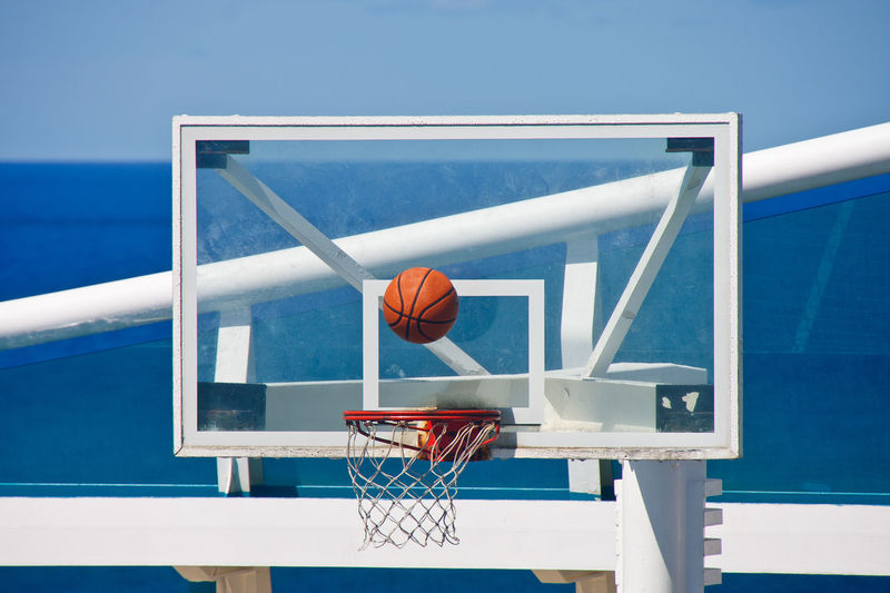 Low angle view of basketball hoop against blue sky