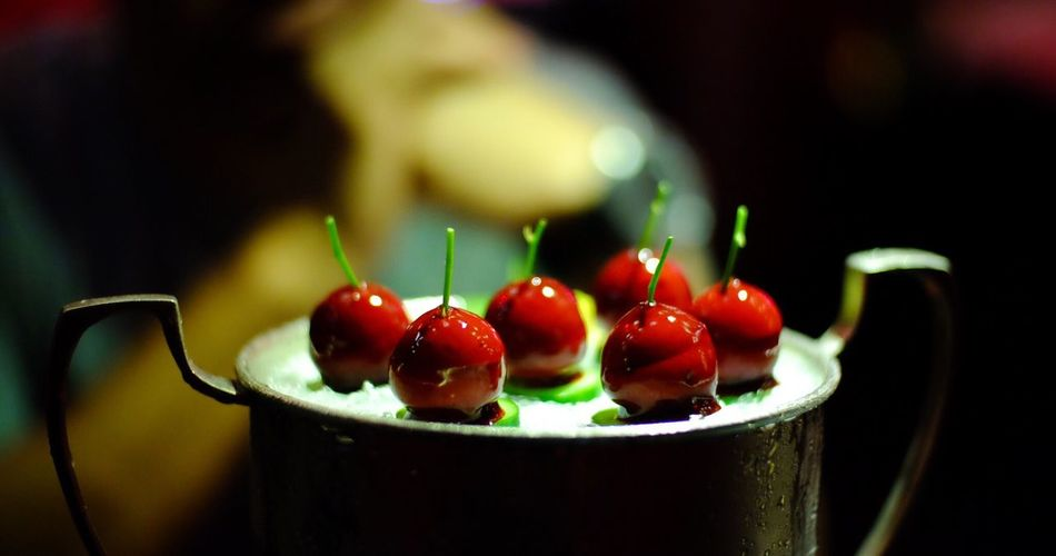 Close-up of red candies on container