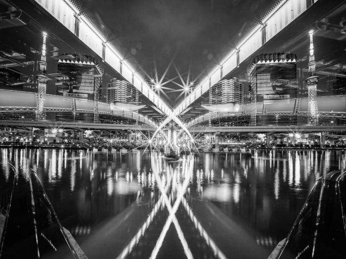 Digital composite image of illuminated bridge at night