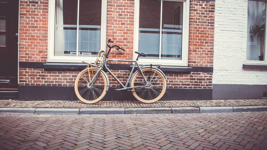 Building Exterior Architecture Bicycle Window Outdoors Built Structure Brick Wall Transportation Mode Of Transport Sidewalk No People City Day Stationary