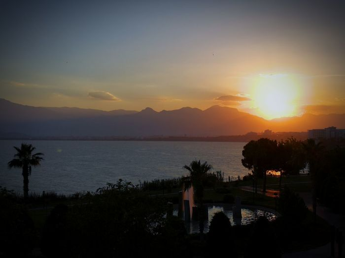 Sunset Tree Sky Sun Water Sea No People LandscapeNature Beauty In Nature Mountain