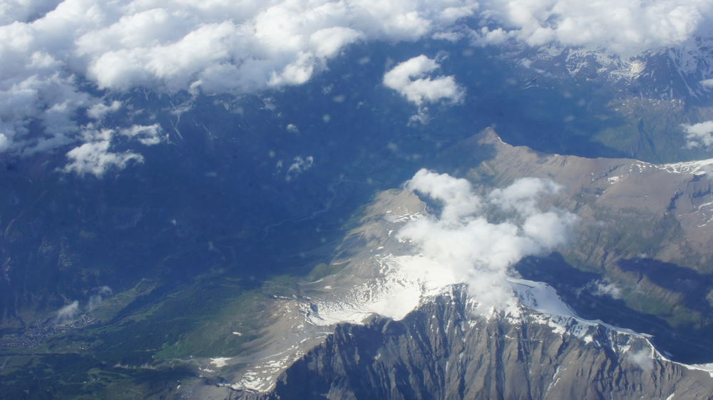 View from airplane window flying above the French Alps towards Lyon Aerial Shot Aircraft Airplane Airplane Window View Alps Beauty In Nature Mountain Nature Scenics Sky Tranquil Scene Tranquility View From Above Wing