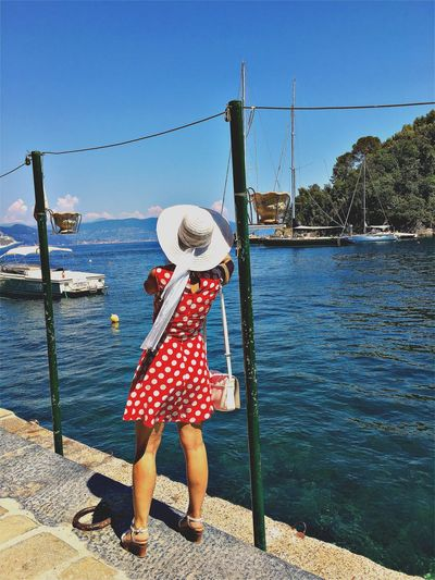Lady. EyeEm Gallery EyeEmNewHere Adult Casual Clothing Clear Sky Day Full Length Italy Leisure Activity Lifestyles Nature Nautical Vessel One Person Outdoors People Popckorn Real People Rear View Sea Sky Standing Water Women The Traveler - 2018 EyeEm Awards