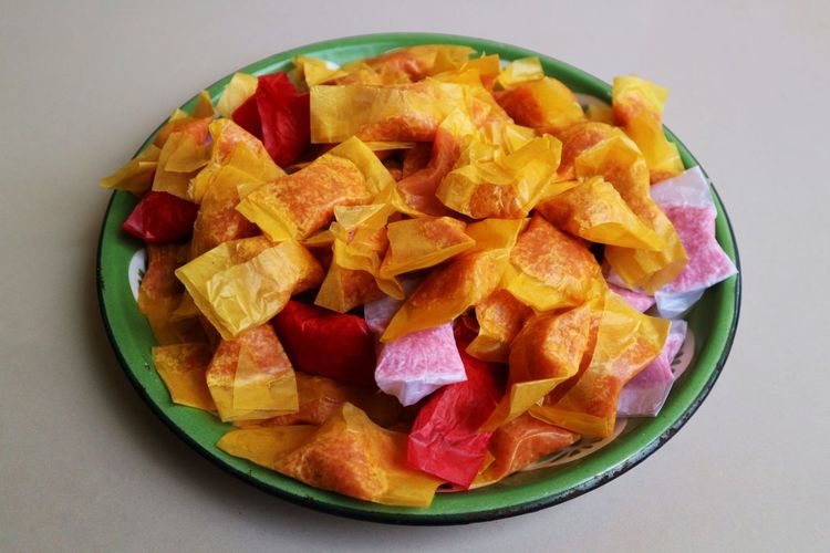 High angle view of chopped fruits in bowl on table