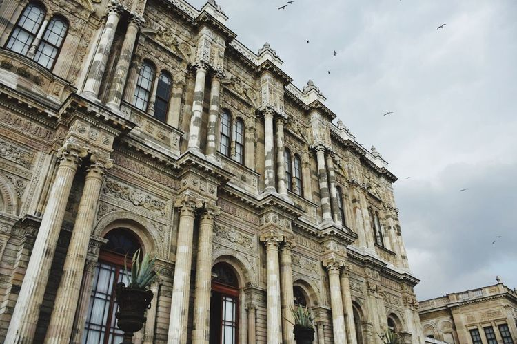 Low Angle View Of Dolmabahce Palace Against Sky In City