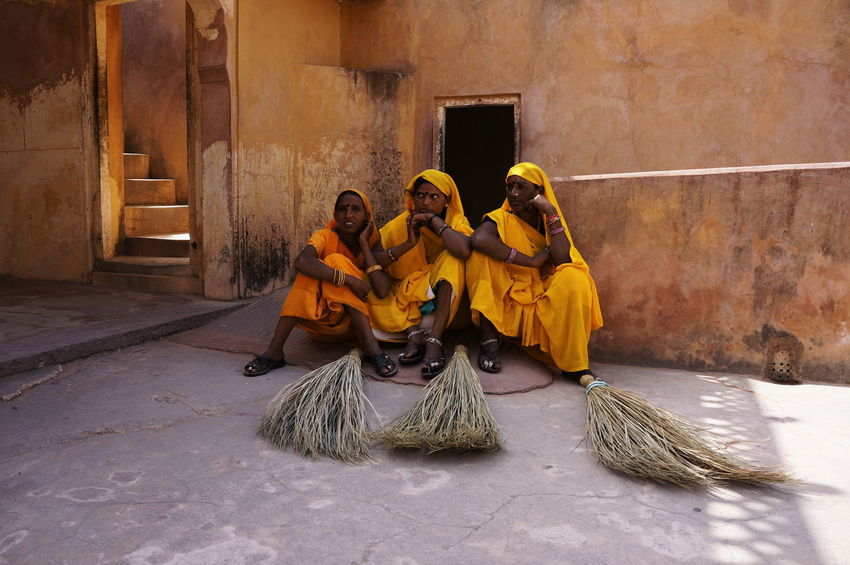 Street Photography Broom Brooms  India Light Photography Real People Sari Sitting Throwback Travel Travel Photography Traveling Women Yellow Business Stories Adventures In The City Traditional Clothing Indian Culture  Palace