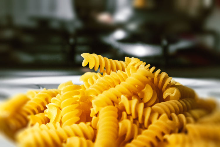 High angle view of pasta in plate Cooking Dinner Food Lunch Macaroni Nature Pasta Carbohydrate Culture Delicious Ingredients No Person Noodles Nutrition Penne Spaghetti Still Life Traditional Wheat Wood Freshness Close-up Yellow Selective Focus Food And Drink No People Indoors  Flower Fragility Spiral Beauty In Nature Vulnerability  Flowering Plant Italian Food Focus On Foreground Pattern Growth Temptation