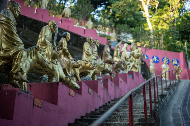 Statues on railing against temple