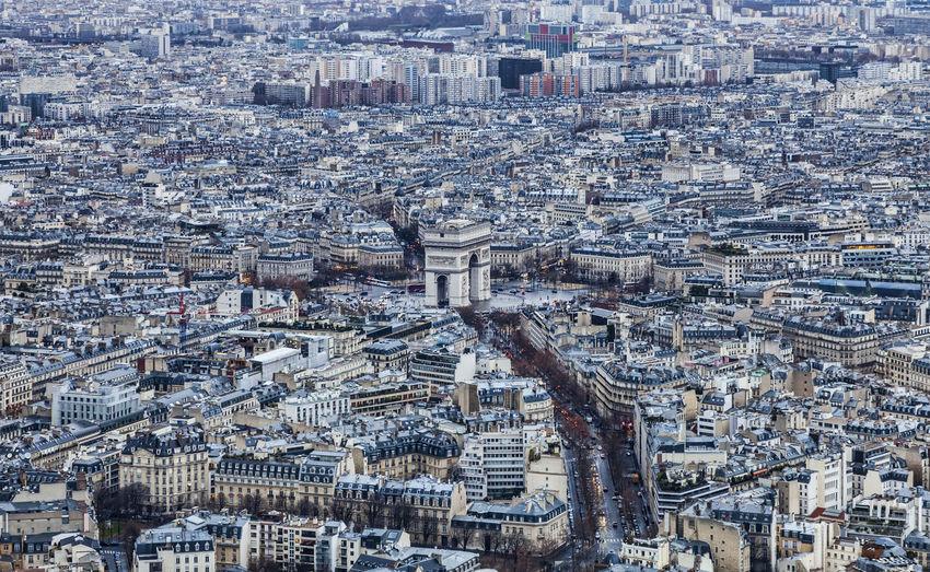 Aerial view of Paris in a cloudy day. Arc De Triomphe, Paris City Cityscape Paris Paris, France  Travel Aerial View Arc De Triomphe Architecture Building Exterior Built Structure Cityscape Crowded Outdoors Roofs Travel Destinations
