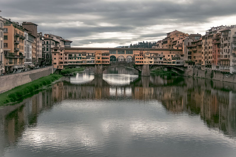 Ponte vecchio over arno river in city