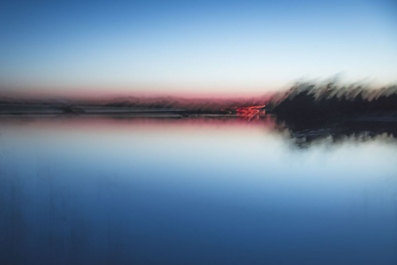 Red lines. Reflection Sky Water Scenics Nature Tranquility Sunset Outdoors Cloud - Sky No People Beauty In Nature Lake Blue Backgrounds Day Nature Sweden Tranquility Icm Pentax Idyllic Clear Sky Sea Landscape Sweden Nature
