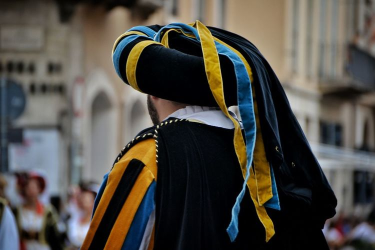 Rear view of man wearing traditional clothing during festival