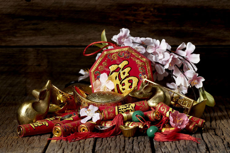 """Happy Chinese new year 2020 year of the rat or lunar new year, Good luck decoration of festive decorations on Old wooden table , copy space for text, (with the character """"fu"""" meaning fortune) Chinese New Year Lunar New Year Good Luck Decoration Festive Wooden Table Luck Mascot Flat Lay Celebration Craft Firecrackers Ornament Gold China 2020 2019 Pig Minimal Sales Envelope Celebrations Flowers Lucky Tradition Symbol Red Fu Background Festival Spring Holiday Traditional Gold Culture Oriental Fortune Asian  ASIA Packet Plum Blossom Design Celebrate Greeting Prosperity Auspicious Money Happiness Firecracker Ingot Indoors  No People Wood - Material Still Life Art And Craft Christmas Text Event Gold Colored Belief Christmas Decoration Close-up Religion Christmas Ornament"""