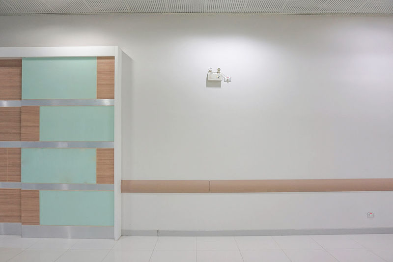 Wall in the hospital. Hospital Wall Absence Architecture Bathroom Blank Built Structure Copy Space Domestic Bathroom Domestic Room Door Empty Entrance Flooring Home Home Interior Hospitality Indoors  Modern No People Simplicity Tile Tiled Floor Wall - Building Feature White Color
