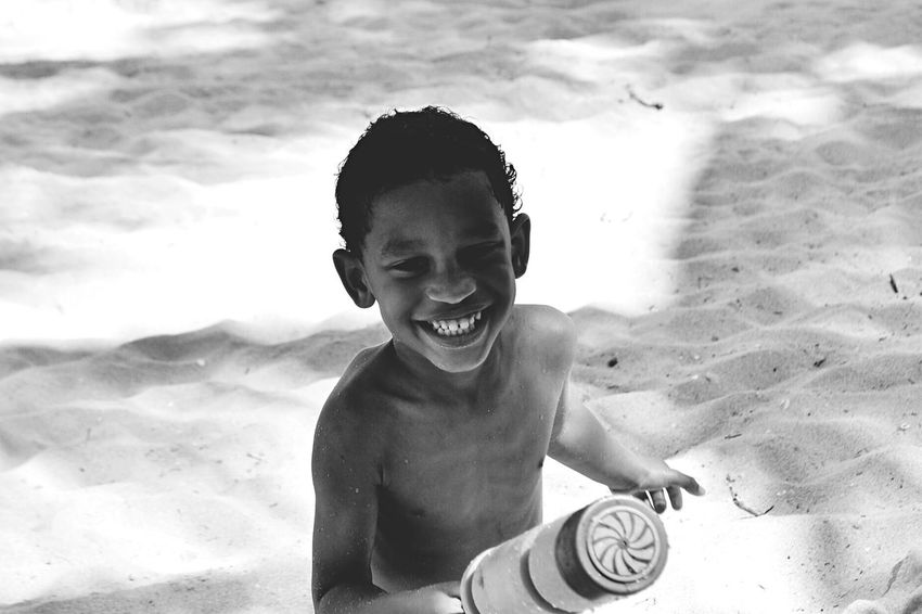 Happy Boy EyeEm Best Shots EyeEm Selects Sandy Beach Sand Land Child Beach Sand Shirtless Childhood Smiling One Person Lifestyles Portrait Nature Leisure Activity Front View Boys Real People Vacations Holiday Outdoors Trip A New Beginning A New Beginning