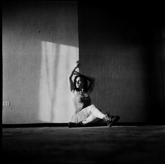 Portrait of woman sitting on floor