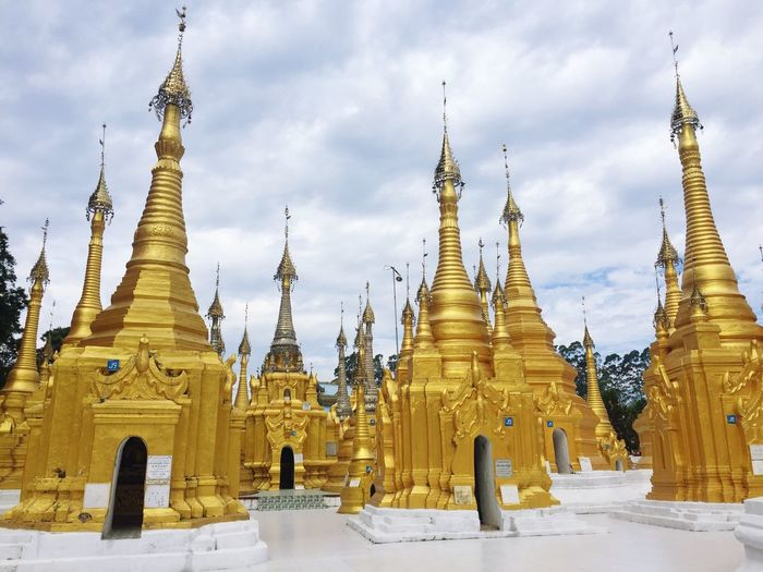 Religion Belief Place Of Worship Spirituality Architecture Sky Built Structure Gold Colored Cloud - Sky Nature Building No People The Past Outdoors Pagoda Spire  Building Exterior