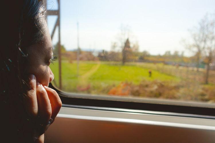 Portrait of man seen through train window