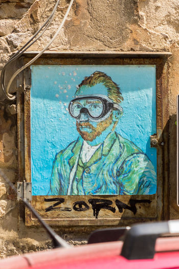 Beautiful street art in Italy Architecture Art And Craft Blue Built Structure Close-up Craft Creativity Day Human Representation Male Likeness Mural No People Outdoors Paint Representation Streetart Turquoise Colored Wall - Building Feature Window