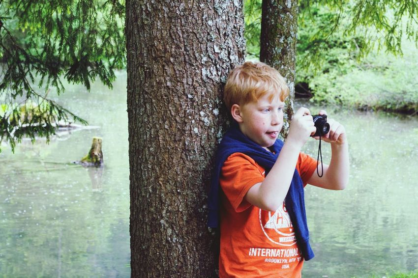 Water Childhood One Animal Child One Person Children Only Day Holding Males  Leisure Activity Outdoors One Boy Only Animal Themes People Boys Lake Nature Blond Hair Tree Salzkammergut Austria Photographer Take Photos