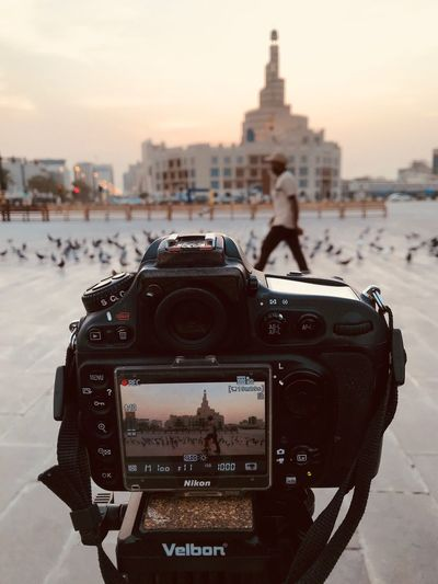 Arabian Moment Technology Photography Themes City Building Exterior Architecture Built Structure Camera - Photographic Equipment Digital Camera Focus On Foreground Retro Styled Photographic Equipment Outdoors No People Sunset Travel Destinations Nature Close-up Camera Sky
