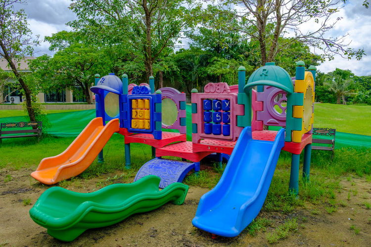 Childhood Day Grass Green Color Multi Colored Nature No People Outdoor Play Equipment Outdoors Park - Man Made Space Playground Playground Slide Sky Tree