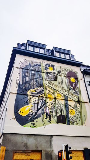 Low angle view of yellow text on building