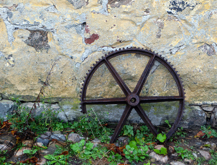 Broken cog against the wall Broken Broken Cog Cog Farm Machinery No People Old Farmyard Outdoors Rusty