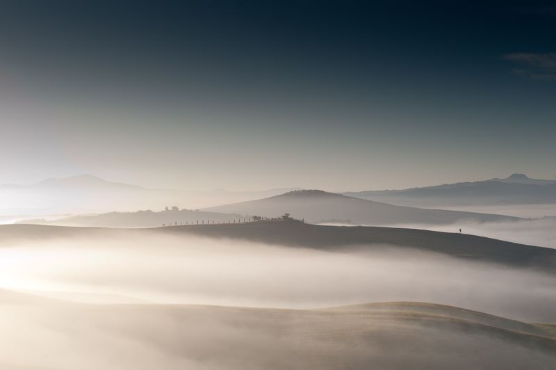 Misty landscape against clear sky