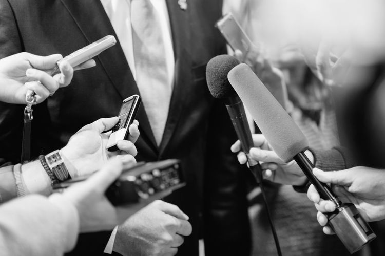 Media Interview With Businessman Black & White Business Interview Journalist Politics Publicity Event Standing Suit Well-dressed Answering Business Person Communication Formalwear Gesturing Human Hand Journalism Marketing Media Interview Microphone Politician Professional Occupation Recorder Sound Recording Equipment Tie Unrecognizable Person