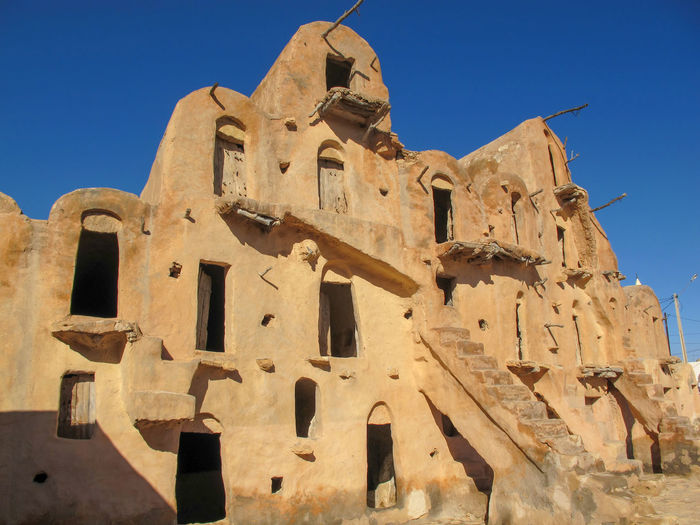 Tunisia Traditional houses, holidays Sky Low Angle View Architecture Built Structure Clear Sky History Sunlight Building Exterior The Past Nature Blue Building No People Day Belief Religion Spirituality Travel Destinations Travel Ancient Outdoors Ancient Civilization Ruined