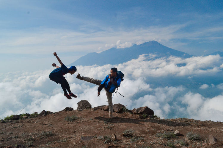 Sky Mountain Cloud - Sky Two People Leisure Activity Full Length Men Adventure Real People Lifestyles Nature Scenics - Nature Mountain Range Day Togetherness Rock People Adult Beauty In Nature Environment Human Arm Outdoors Positive Emotion Freedom
