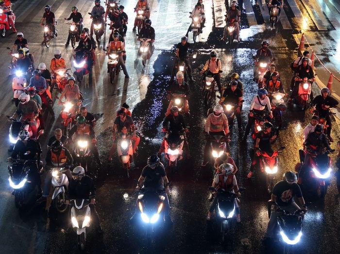 Motorcycles on illuminated street