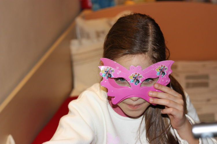 Portrait of girl wearing eye mask