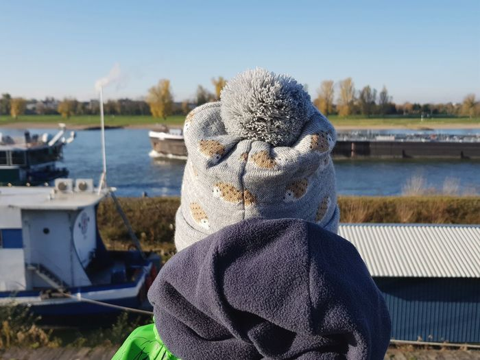 Boat watching Water Rear View Sky Nature Nautical Vessel Warm Clothing Close-up Mommylife Boy Curiosity From My Point Of View Growing Up Happiness Winter EyeEm Best Shots Childhood The Week On EyeEm Toddler  Child Boats Shore River Human Body Part Hat Headgehog Stories From The City