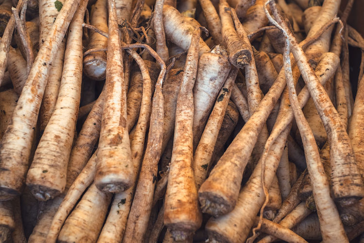 raw parsnip with earth at the market stall Earth Raw Vegetarian Food Abundance Backgrounds Brown Chinese Food Close-up Day Food Food And Drink For Sale Freshness Full Frame Healthy Eating Heap Large Group Of Objects Market Market Stall No People Outdoors Parsnip Raw Food Retail  Root Vegetable Street Market Vegetable Wellbeing EyeEmNewHere