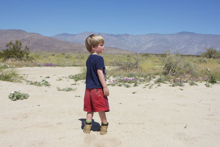 a boy and his desert Arid Climate Blond Hair Boys Child Childhood Children Only Clear Sky Day Desert Desert Full Length Males  Mountain Nature One Boy Only One Person Outdoors People Sand Dune Sky Standing Breathing Space Been There. Lost In The Landscape Connected By Travel Be. Ready. California Dreamin