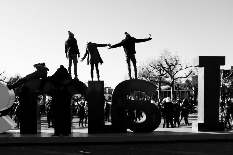 Silhouette people standing against clear sky