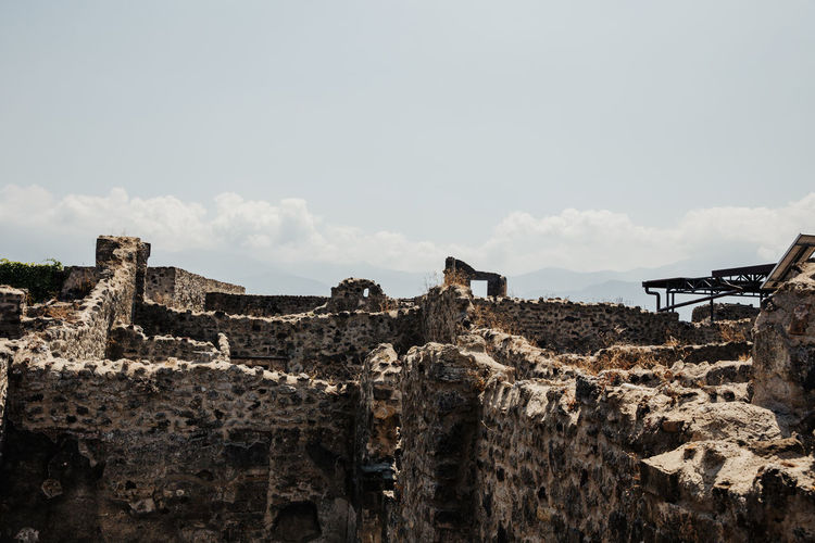 Pompeii  Ruins Ruins Architecture Pompeii Ruins Italy Architecture History Built Structure The Past Old Ruin Cloud - Sky Ancient Building Exterior Wall Damaged Abandoned Solid Building Travel Destinations Copy Space Stone Wall Ruined Deterioration Ancient Civilization Outdoors