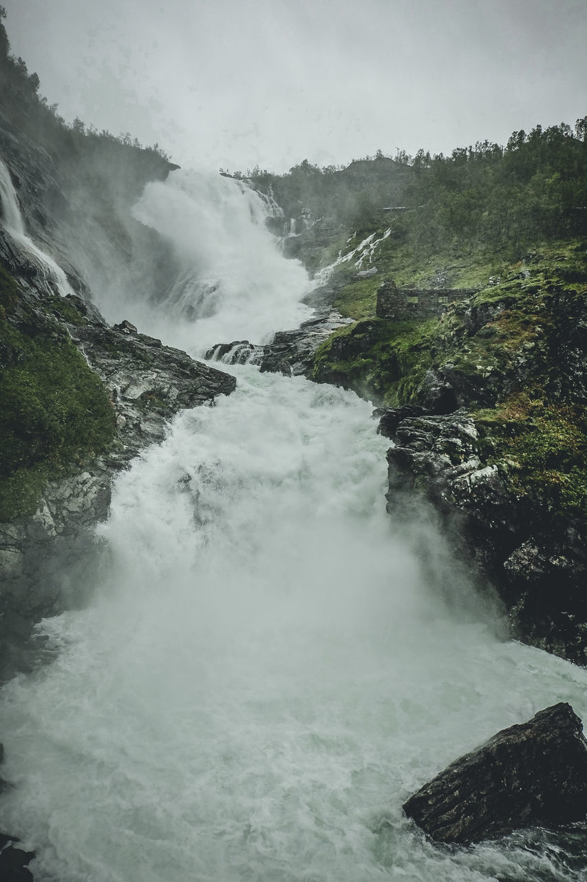 scenics - nature, water, beauty in nature, motion, nature, no people, flowing water, power in nature, environment, tree, power, long exposure, waterfall, travel destinations, blurred motion, non-urban scene, flowing, day, rock, outdoors