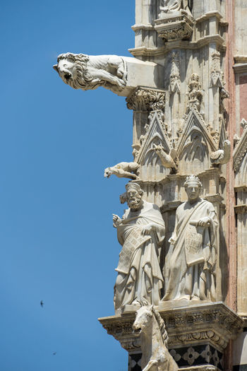 Shot in the city of Siena, Italy Architecture Art And Craft Blue Built Structure Clear Sky Craft Creativity Day History Human Representation Low Angle View Male Likeness Nature No People Outdoors Representation Sculpture Sky Statue The Past Travel Destinations