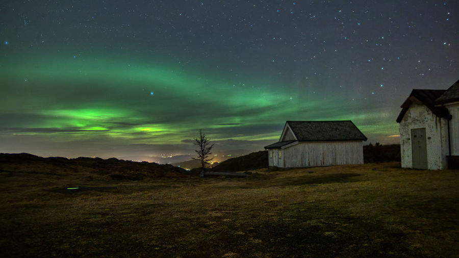 Aurora over Bergen. Sky Night Architecture Scenics - Nature Built Structure Beauty In Nature Building Star - Space Building Exterior No People Space Green Color Nature Astronomy Cloud - Sky Landscape House Tranquil Scene Environment Tranquility Aurora Borealis Northern Lights Long Exposure