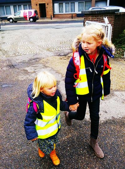 School Is Out. Sisters. Learning. Walking Home From School . Talking Everyday Education . Holding Hands Safety Vest. Kidsphotography Hello World