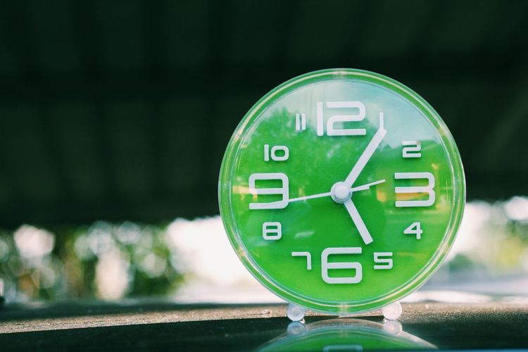 Close-up of green clock