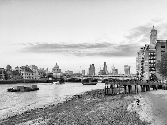 Thames Cyclist Architecture Building Exterior City Built Structure Cityscape Skyscraper Urban Skyline Travel Destinations River Sky Water Transportation Cloud - Sky Outdoors Nautical Vessel Day No People Cycling Cyclist Embankment London Blackandwhite Postcode Postcards